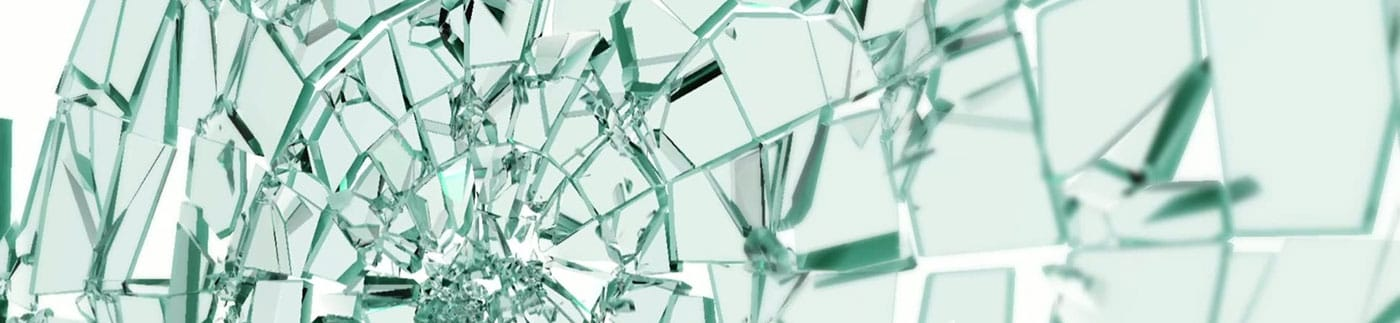 A fragile pane of glass captured in the moment of shattering